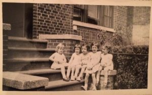 Tara on front stoop of 2054 78th Street